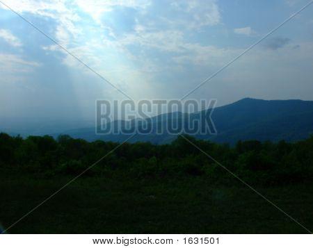 Sun Beam On Mountains