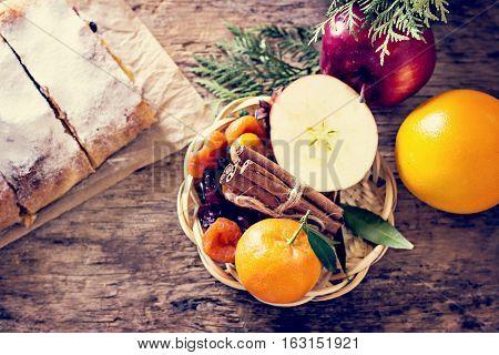 Apples, Oranges, Tangerines, Cinnamon In A Basket.