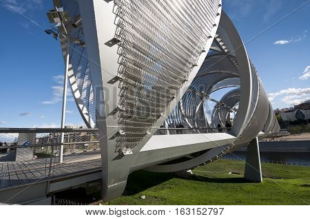 Arganzuela Bridge on 15 April 2013 in Madrid Rio Park Madrid Spain. Designed by Dominique Perrault it is 274 metres in lenght and formed by two spiral-shaped walkways connected by a hill giving access to Arganzuela Park.