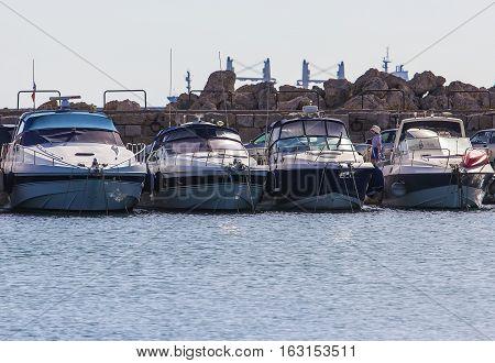 Rhodes island landmark, Mandraki Port, Greece. four luxury white large yacht at the anchor