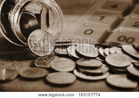 Double exposure rows of coins with utility bill and calculator and account banking for finance concept Money and finance concept