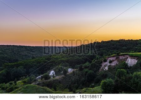 Sunset over the forest on the chalk hills