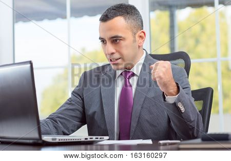 Portrait Of Ambitious Young Businessman Who Succeeded