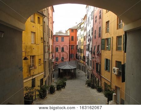 Bright colored vintage building in the old town of Genoa, Italy