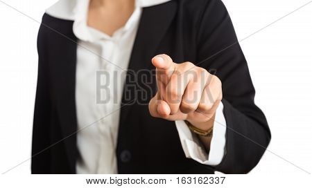 Female hand of business woman pointing index finger at viewer or camera with white background