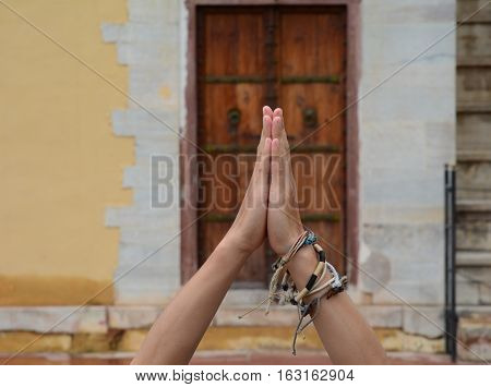 Praying Hands With Wooden Door Background