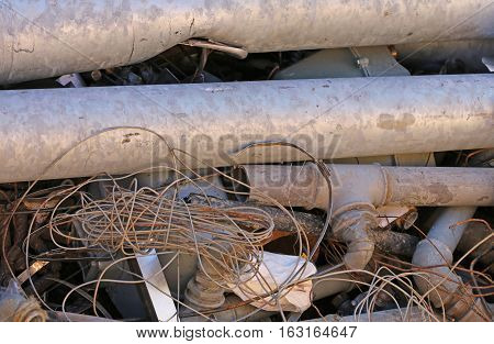 Rusty Iron Pipes And Other Ferrous Material In A Landfill