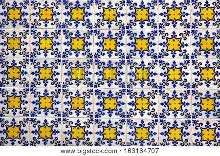Typical Portuguese old ceramic wall tiles (Azulejos) on the building exterior Portugal. Seamless Azulejos pattern can be used for wallpaper pattern fills webpage background surface textures