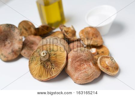 Mushrooms Stacked On A White Background.