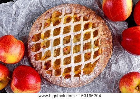 Home baked Lattice apple pie on crumpled paper.