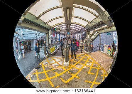 Hong Kong, China - December 4, 2016: fisheye view of Mid-levels escalator, a system of escalators and walkways connecting Central to Western District. The beginning of system on Queen's Road Central