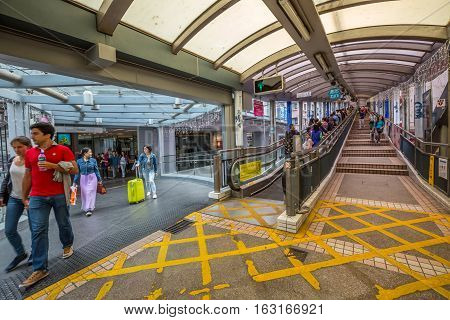 Hong Kong, China - December 4, 2016: people on Mid-levels escalator, a system of escalators and walkways connecting Central to Western District. The beginning of system on Queen's Road Central