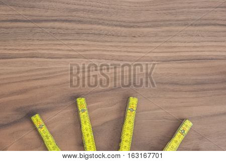 Measuring tool wooden meter stick on a table