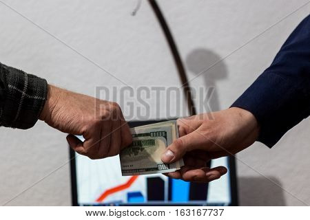 Two Guys Or Businessmen Trade Exchange Folded Dollars From Hand To Hand Economy