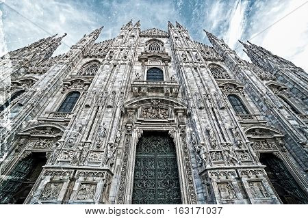 Old photo with facade of the famous Milan Cathedral Lombardy Italy. Vintage processing.
