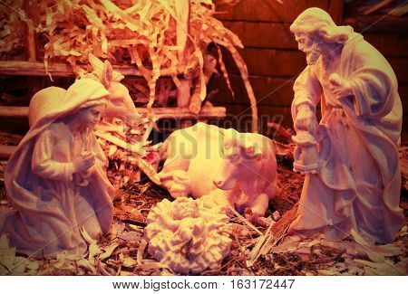 Nativity Scene With Beautiful Wooden Statues And The Manger