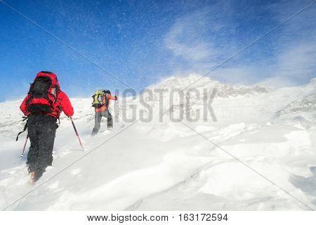 ski mountaineering ascending to the top during a winter snowstorm