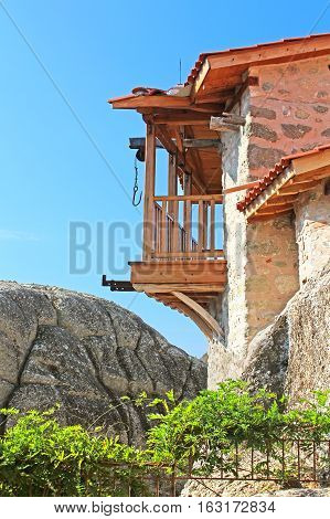 Wooden balcony with hook for lifting things in monastery of the Holy Trinity (1475), Meteora, Greece