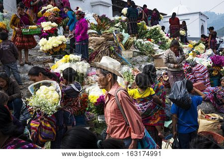 Chichicastenango Guatemala - April 27 2014: Local people in a street market in the town of Chichicastenango in Guatemala