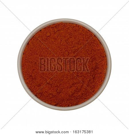 Bitter paprica spices in a small dish isolated on a white background