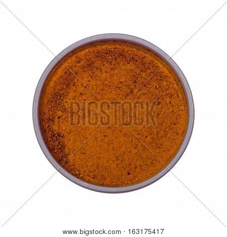 Saffron spices - Powder in a small dish isolated on a white background