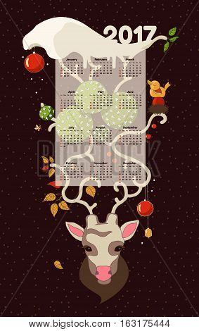 Christmas deer.Calendar 2017. Hand Drawn Vector Illustration. Deer antlers snow and hanging Christmas decorations.All the seasons are on the horns of a deer
