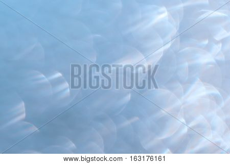 abstract soft blue bokeh circles light and blurred boke