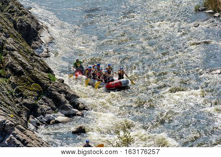 RIVER SOUTHERN BUG UKRAINE - APRIL 17 2016: Rafting April 17 2016 River Southern Bug Ukraine. Group of people floated on the river.