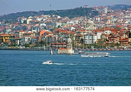 Maiden's Tower and ferries in Istanbul, Turkey