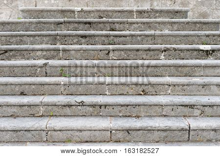 Ancient marble staircase, frontal view. Old staircase