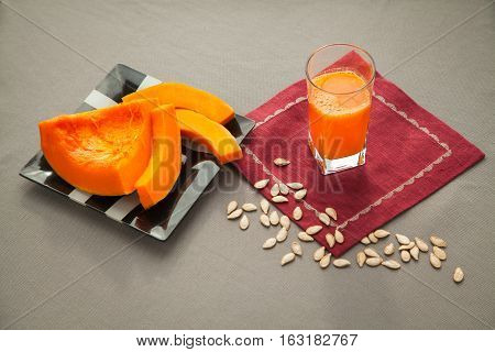 Fresh just squeezed pumpkin juice in the glass. Healthy drink for people who have diet. Full of vitamins beverage.