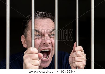 Middle-aged Man Kept Captive In A Prison Cell