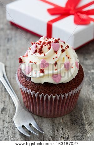 Sweet Valentine cupcakes on wooden table background