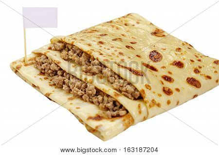 Pancake in a form of a pocket stuffed by forcemeat white background close up view