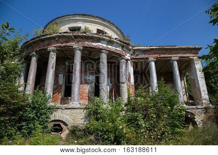 Abandoned ruins of mansion of Earl Voeikov, facade with columns. Penza Region, Russia