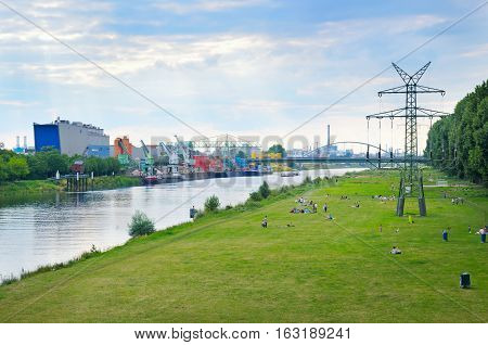 Resting place of people on the banks of the River Neckar in the industrial area of the city of Mannheim Germany