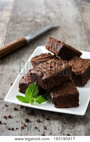 Sweet Chocolate brownie pieces on wooden background