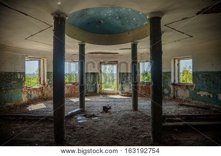 Interior of ruined round hall with columns at abandoned mansion Earl Voeikov, Penza Region, Russia