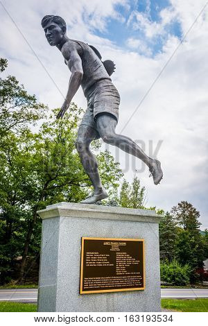 JIM THORPE PENNSYLVANIA - SEPTEMBER 28: The Jim Thorpe discus monument in his Memorial Park on September 28 2016 in Jim Thorpe Pennsylvania.