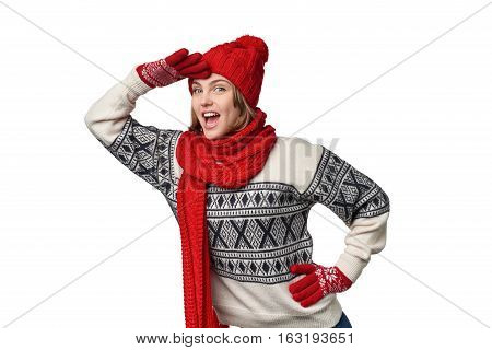 Happy excited winter woman holding palm on forehead observing screaming, over white background