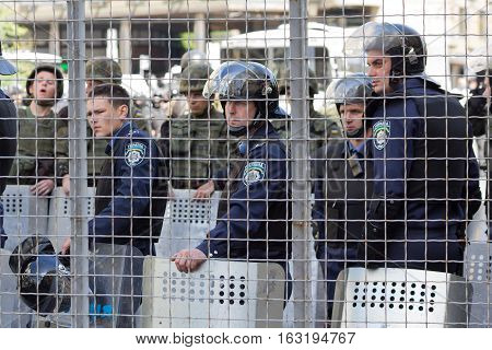 Kiev Ukraine - June 12 2016: Cordon of police clad in armor protecting the participants of the gay parade from the radicals