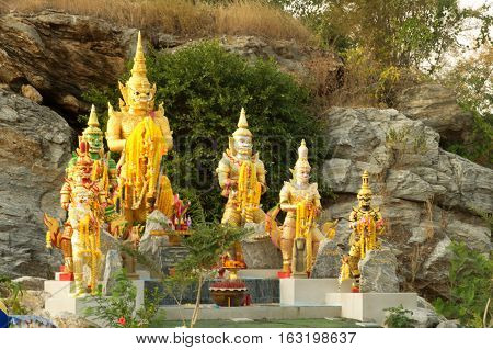 SUPHANBURI,THAILAND-DECEMBER 11,2016 : Group of giant guardians on Pha Mungkonbin cliff in Wat Khao Tham Thiam , U Thong District ,Suphanburi District in Middle of Thailand.