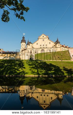 Nesvizh Belarus - August 20, 2016:Nesvizh Castle is a residential castle of the Radziwill family. View with reflection in the castle moat