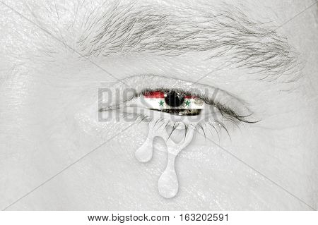 Crying eye with Syria National Arab Republic Flag iris on black and white face. Concept of sadness for Syrian civil war, patriotic metaphor.