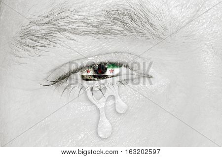 Crying eye with Syria Independence National Coalition Flag iris on black and white face. Concept of sadness for Syrian civil war, patriotic metaphor.