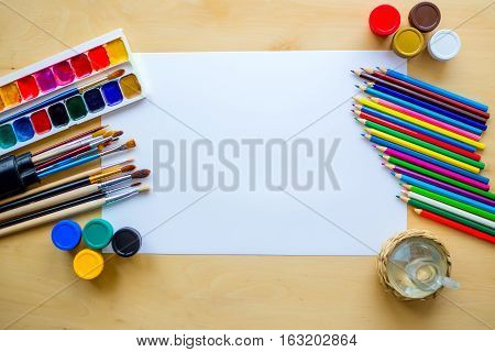 Drawing Supplies Brushes, Pencil, Aquarelle, Gouache, Paper On Wooden Background