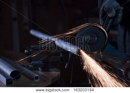 metal cutting close up, a metal cutting saw slicing through a steel pipe, metal sparks, manual cutting metal tube, metal sawing close up, a lot of metal sparks, metal cutting with grinder sparks flying around