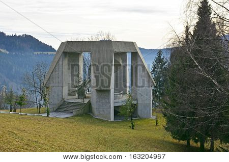 Drazgose Slovenia - December 25th 2016. The Drazgose Spomenik World War Two memorial which stands outside of the village of Drazgose. The memorial commemorates the 1942 Battle of Drazgose.