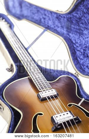 Vintage archtop semi-acoustic bass guitar in tweed case