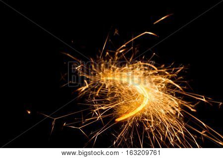 The orbit of the comet. The trajectory of the sparks to arc
